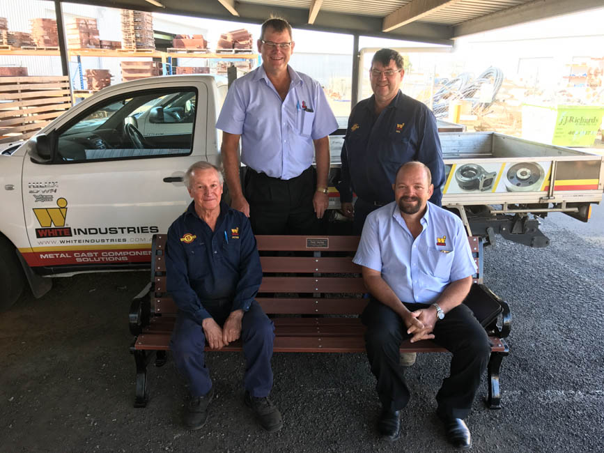 Peter Gourley being presented his chair by Bruce, Neil (standing) and Craig (sitting)